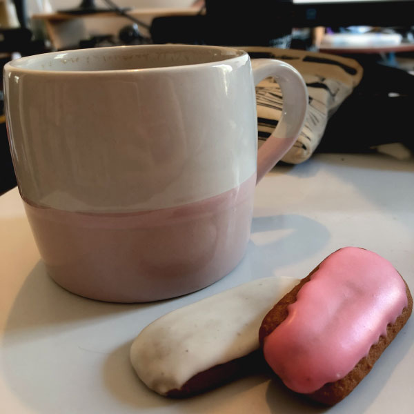 a photo of a cup of coffee and two honey jumble biscuts